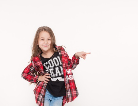 school girl pointing with finger away isolated on white.