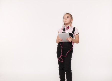 young girl using computer tablet Stock Photo