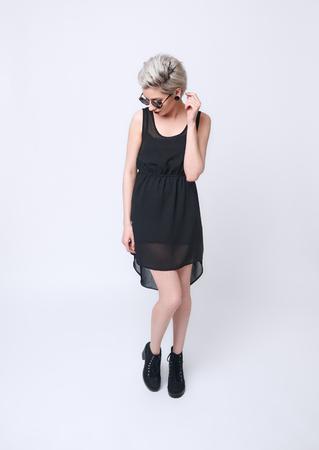 BLond Girl in black dress on white background