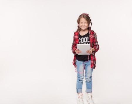 girl holding a tablet isolated on white background
