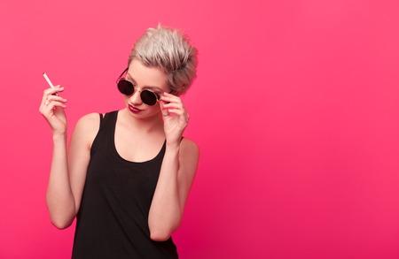 fashion blonde with stylish short hairstyle smoking cigarette