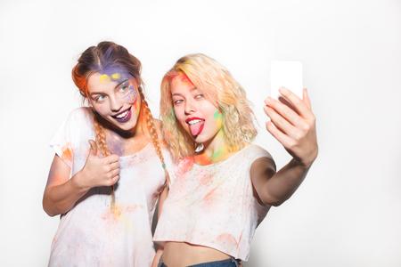 Women in Holi colors taking selfie