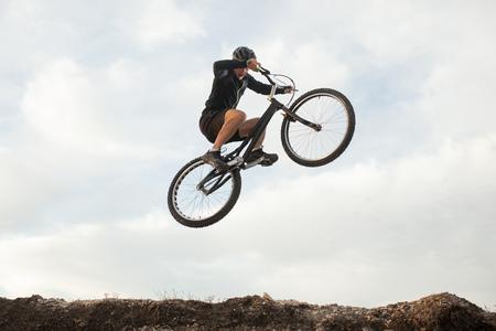 man jumping on a bike
