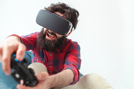 Man playing the game in VR headset Stock Photo
