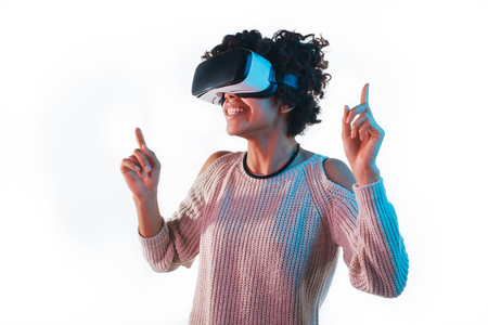Woman in VR helmet pointing up