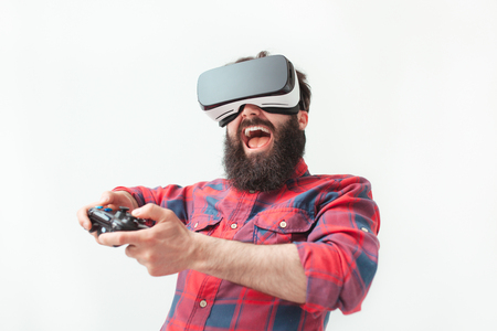 Excited man playing a VR game