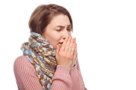 copys pace: Sick female sneezing on white