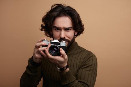 Man met fotocamera Stockfoto
