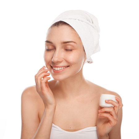 Smiling woman applying cream