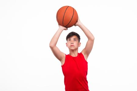 beginner: Teen player throwing ball Stock Photo
