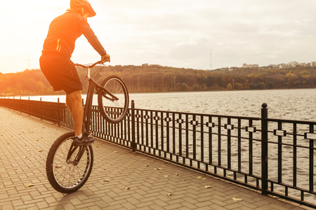 Man balancing a bicycle on the esplanade Stock Photo - 79161448