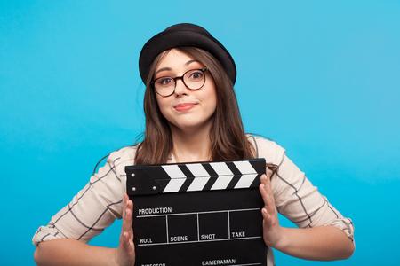 Girl holding clapperboard