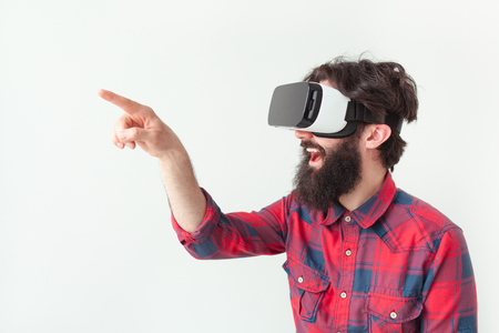 Man pointing air in VR goggles