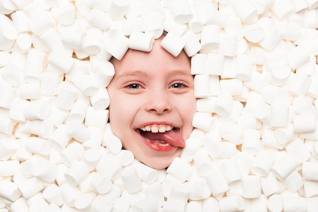 Smiling boy in marshmallows