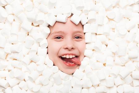Smiling boy in marshmallows Stok Fotoğraf - 80246440