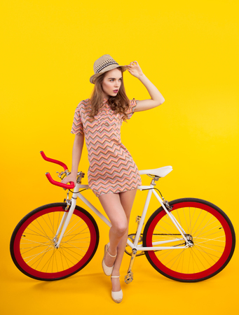 Confident model posing with bicycle