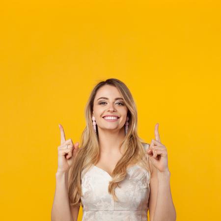 Elegant girl smiling and gesturing up