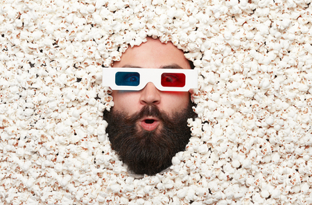 Excited man in stereo glasses Stock Photo