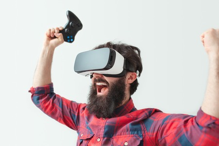 Man with gamepads in VR headset