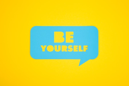 Be yourself text in a bubble