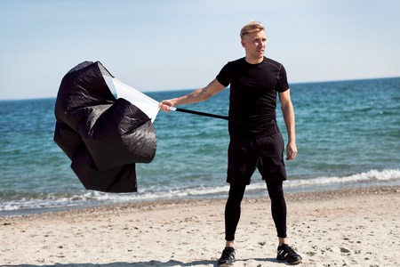 Man standing with running parachute