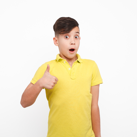 Adorable boy showing thumb up Imagens