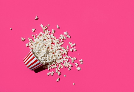 Spilled popcorn on pink