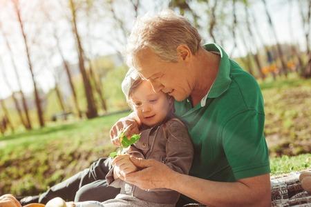 granddad: Man with granddaughter exploring plant