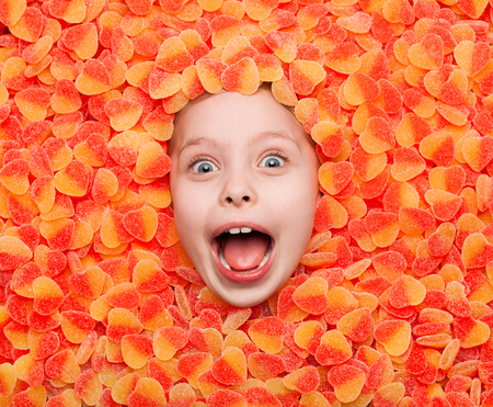 Excited boy in sweets Stock Photo