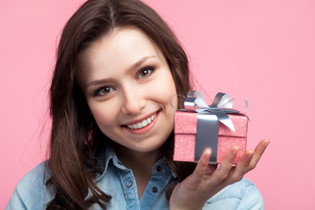 Young happy woman with giftbox Фото со стока