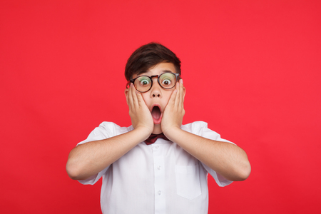 Expressive kid on red Stock Photo