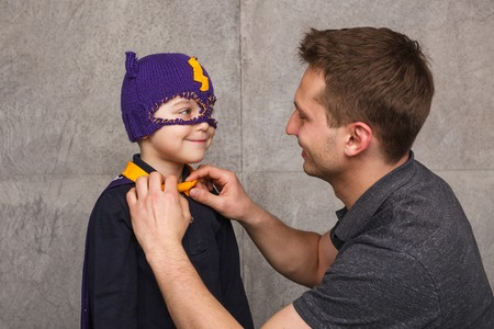 Father with child in superhero costume