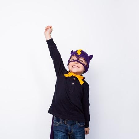 Boy in hero hat posing