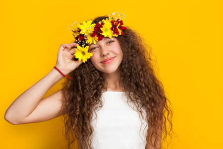 Pretty girl posing with flower crown Stock Photo