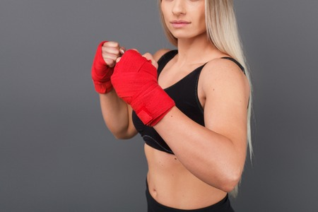 Woman holding hands in boxing pose