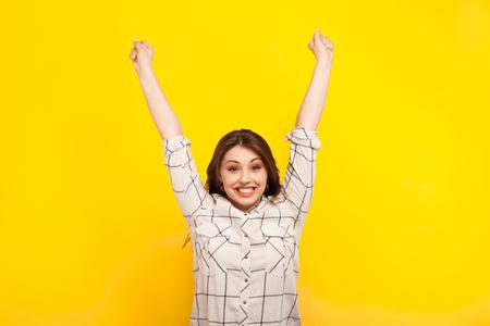 Happy woman posing in victory Reklamní fotografie