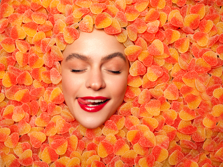 Delighted model posing in fruit jelly