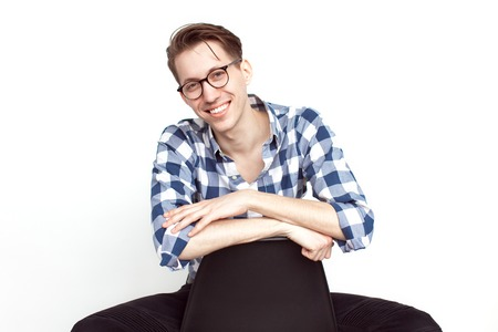 Man in glasses posing on chair