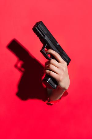 Hand holding pistol gun Stock Photo