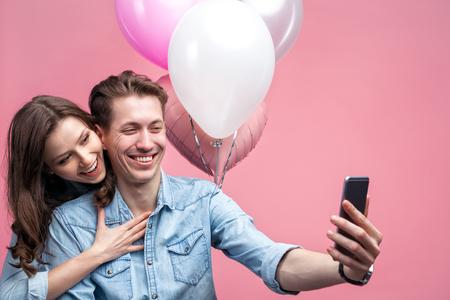 Celebrating couple taking selfie Stock Photo
