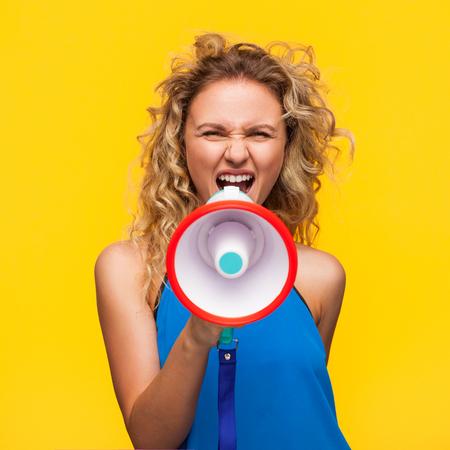 Woman yelling with loudspeaker