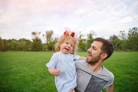Father with daughter having fun in park