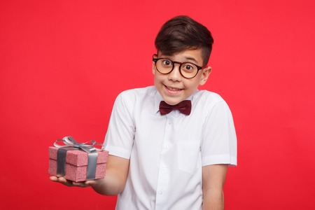 Smiling boy posing with giftbox