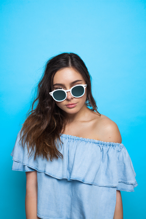 Attractive girl looking over sunglasses