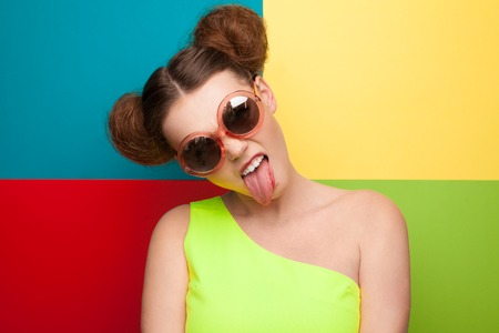 Girl in sunglasses showing tongue