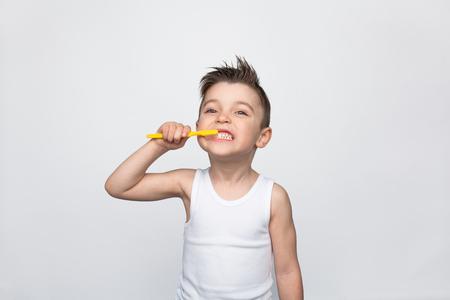 Little boy brushing teeth Stock fotó