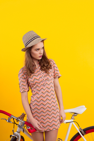 Stylish woman with bicycle in studio Stock Photo
