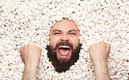 Victorious man posing in popcorn