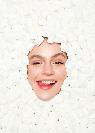Coquettish model posing in white marshmallows