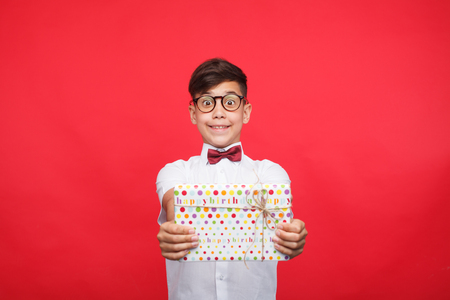 Excited boy showing present Stock Photo